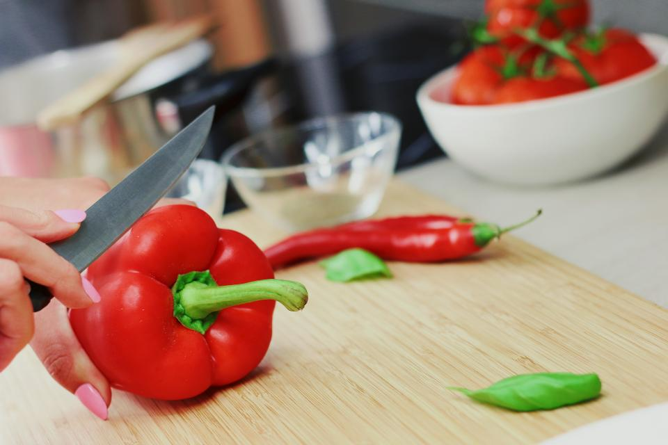 Cutting up red pepper