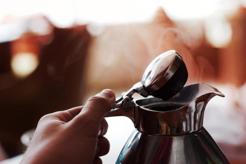 Hand holding kettle